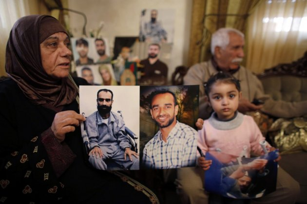 Layla al-Issawi holds a picture of her son Samer, who has been on hunger strike for 209 days while being held in an Israeli prison, at her home in the East Jerusalem neighbourhood of Issawiya February 17, 2013. (Photo: Reuters)