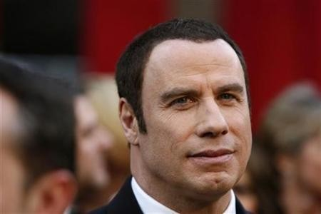 Is Oscar presenter John Travolta turning into Silvio Berlusconi?