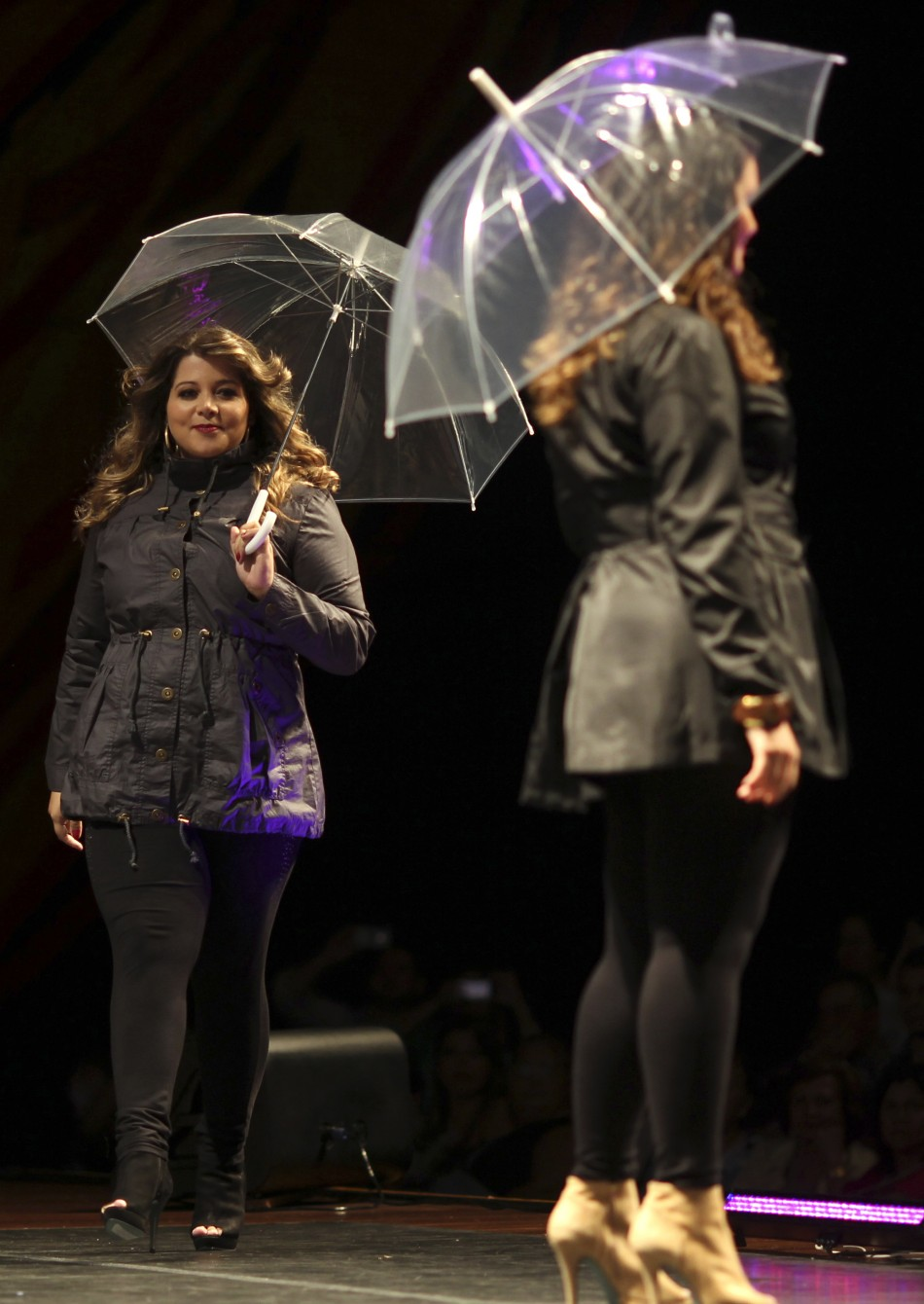 Models walk the runway during a presentation as part of Fashion Weekend Plus Size FallWinter 2013 collection show in Sao Paulo February 23, 2013.