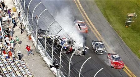 A car ploughs into the fence during the NASCAR Daytona 2013.