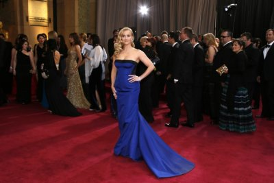 Actress Reese Witherspoon, wearing a black and royal blue Louis Vuitton gown, arrives at the 85th Academy Awards in Hollywood, California February 24, 2013