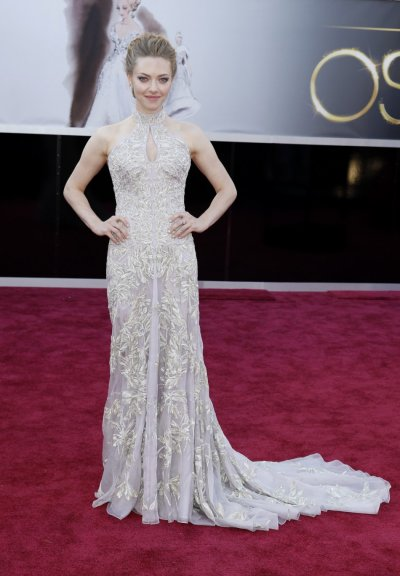 Actress Amanda Seyfried, from Les Miserables, wearing an Alexander McQueen dress, arrives at the 85th Academy Awards in Hollywood, California, February 24, 2013.