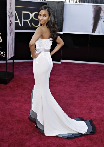 Actress Zoe Saldana from Star Trek, wearing a belted Alexis Mabille gown, arrives at the 85th Academy Awards in Hollywood, California February 24, 2013.