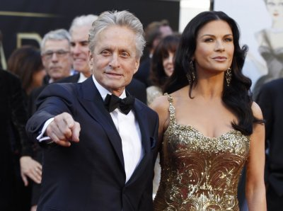 Actor Michael Douglas and his wife, actress Catherine Zeta-Jones, who is wearing a Zuhair Murad gown and Lorraine Schwartz jewels, arrive at the 85th Academy Awards in Hollywood, California, February 24, 2013.