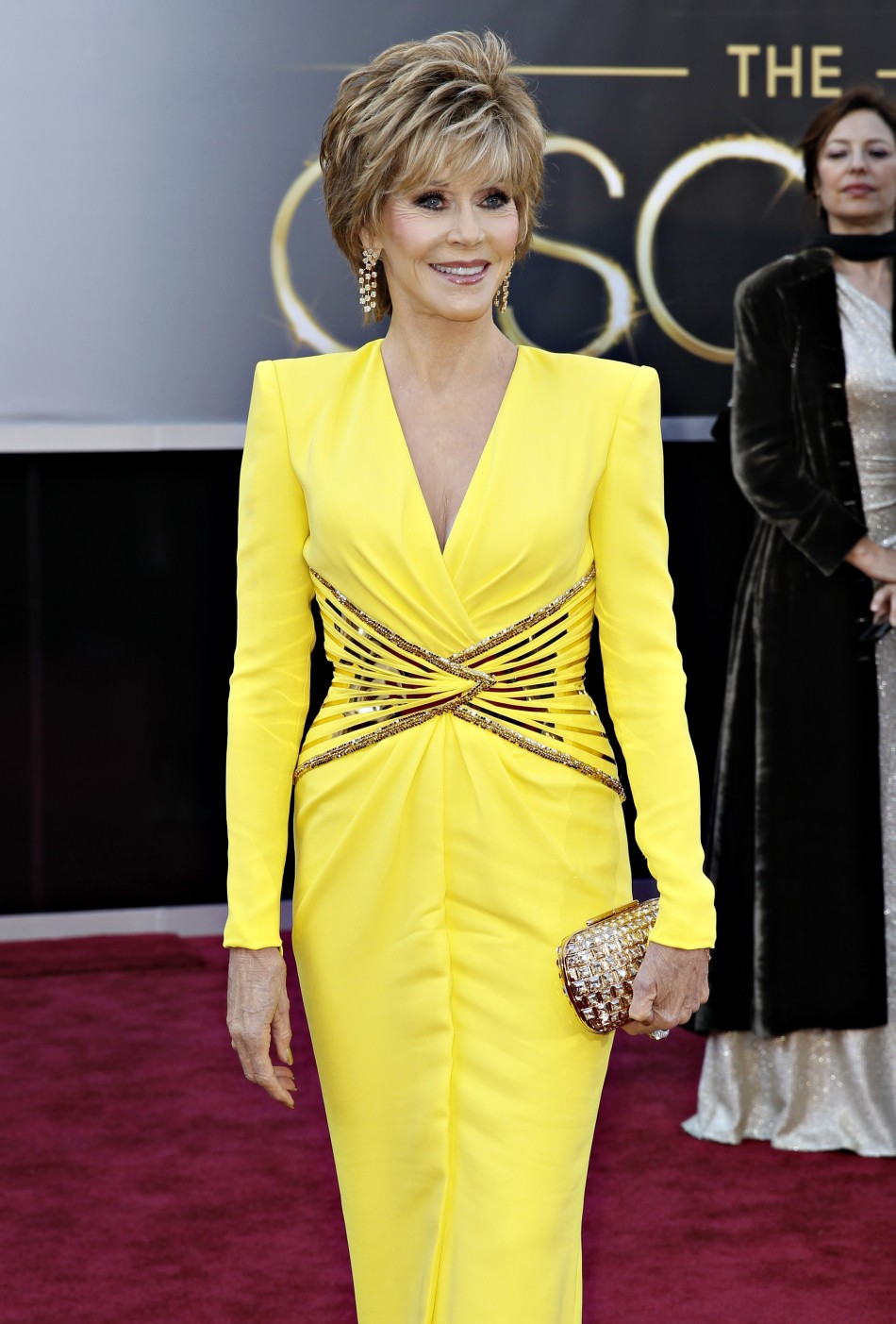 Two-time Academy Award winner Jane Fonda, wearing a yellow Versace gown, arrives at the 85th Academy Awards in Hollywood, California February 24, 2013.