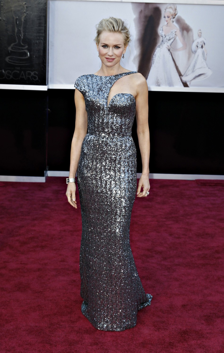 Best Actress nominee for The Impossible Naomi Watts wearing an Armani Prive dress, Jimmy Choo shoes, Neil Lane jewels, and carrying a Roger Vivier bag, arrives at the 85th Academy Awards in Hollywood, California February 24, 2013.