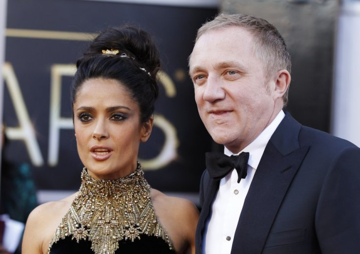 Actress Salma Hayek and her husband Francois-Henri Pinault arrive at the 85th Academy Awards in Hollywood, California February 24, 2013.