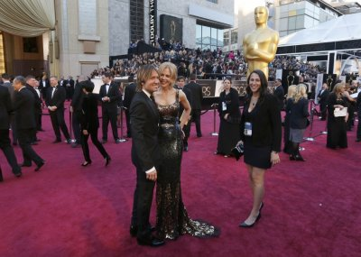 Keith Urban and Nicole Kidman arrive at the 85th Academy Awards in Hollywood, California February 24, 2013