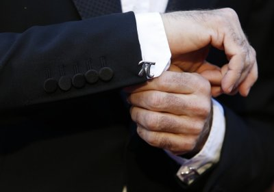 Mychael Danna co-star in the film Life of Pi shows his cufflink during arrivals at the 85th Academy Awards in Hollywood, California February 24, 2013.
