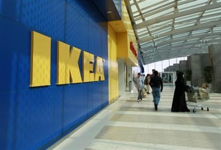 Customers walk near the entrance of an IKEA store (Reuters)