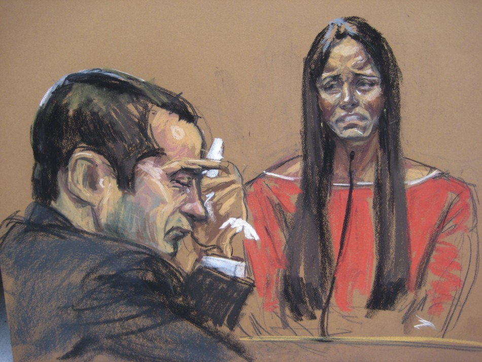 Former New York City police officer Gilberto Valle (L) listens as his wife Kathleen Mangan testifies in this courtroom sketch on the first day of his trial' (Reuters)