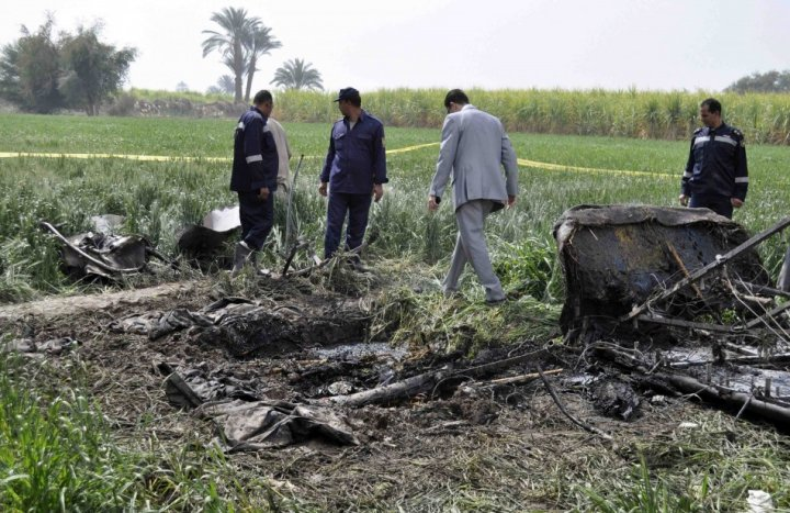 Police and rescue officials check the wreckage of a hot air balloon that crashed in Luxor (Reuters)