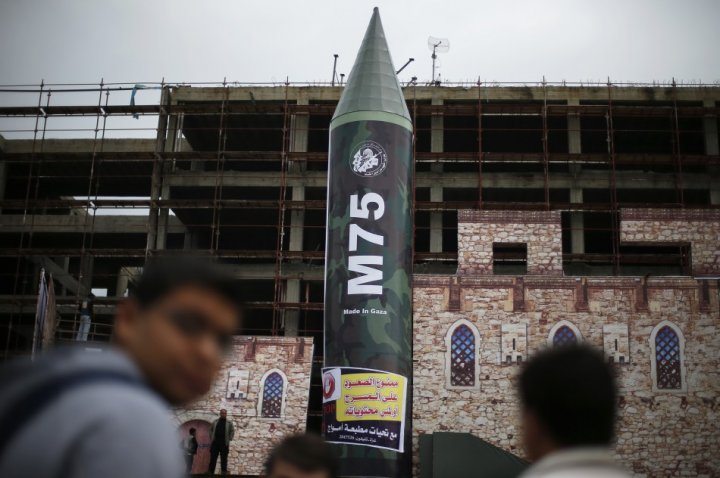 A gigantic model of a local-made M75 long range rocket is seen on stage during a preparations for Hamas rally in Gaza City December 5, 2012.
