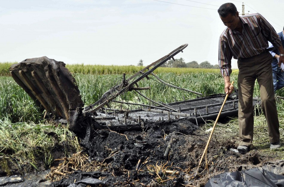 A man examines the wreckage of a hot air balloon that crashed in Luxor  (Reuters)