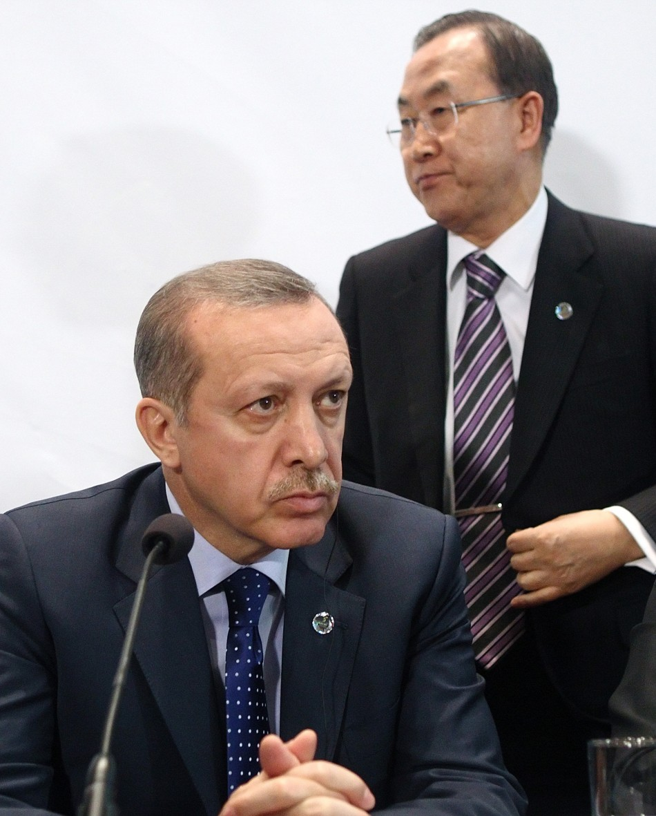U.N. Secretary General Ban Ki-moon (R) passes Turkey's Prime Minister Tayyip Erdogan as he leaves a news conference after the opening session of the fifth United Nations Alliance of Civilizations (UNAOC) Forum in Vienna