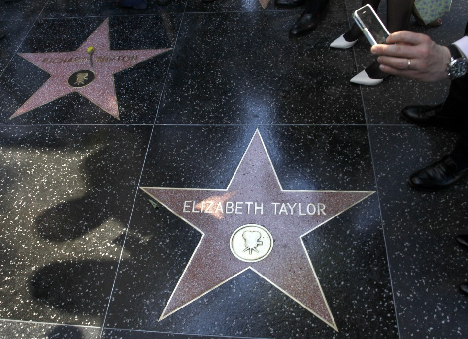 Late actor Richard Burtons star is pictured next to actress Elizabeth Taylors star after the Hollywood Walk of Fame posthumously honored the actor in Hollywood, California, March 1, 2013.