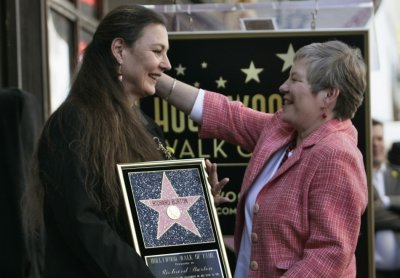 Maria Burton L, daughter of Richard Burton, is greeted by British Consul-General Dame Barbara Hay at a ceremony posthumously honoring actor Richard Burton with a star on the Hollywood Walk of Fame in Hollywood, California, March 1, 2013.