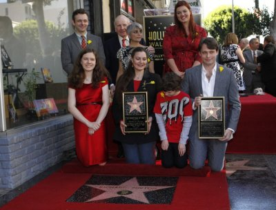 Family members and friends pose together during a ceremony posthumously honoring actor Richard Burton with a star on the Hollywood Walk of Fame in Hollywood, California, March 1, 2013.