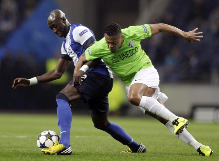Eliaquim Mangala (R) and Julio Baptista