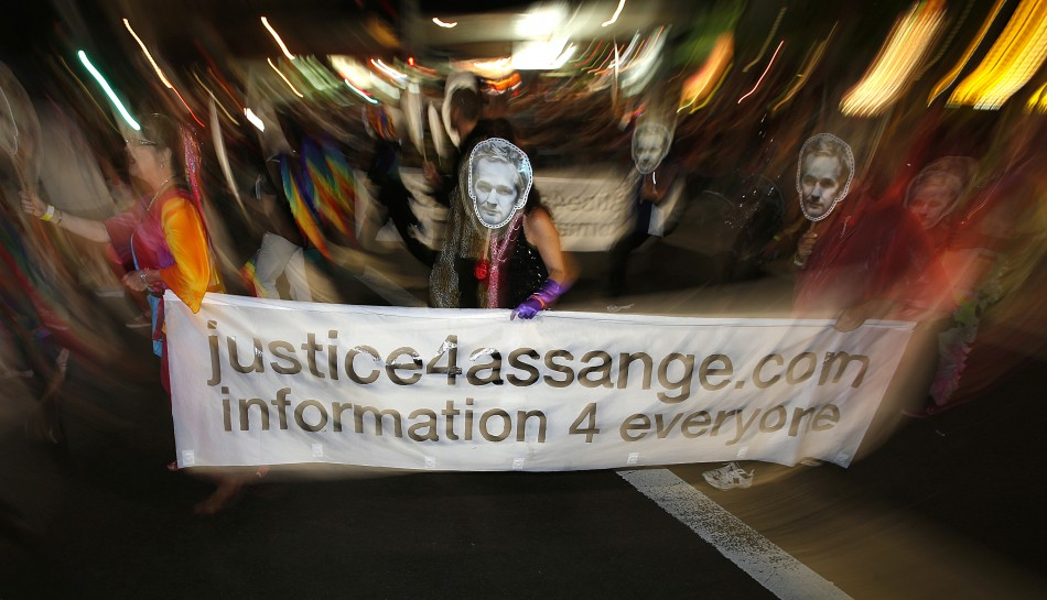 Members of the group Save Assange Wikileaks Coalition participate in the 35th annual Sydney Gay and Lesbian Mardi Gras parade March 2, 2013.