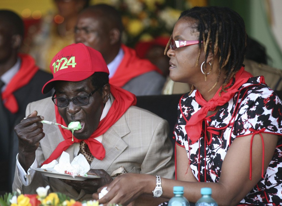 Zimbabwes President Robert Mugabe eats cake next to his wife Grace during an event marking his 89th birthday at Chipadze stadium in Bindura, about 90 km 56 miles north of the capital Harare March 2, 2013. Addressing a rally to mark his 89th birthd