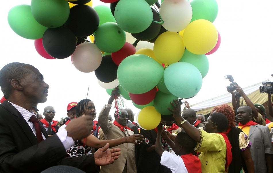 Zimbabwe's President Robert Mugabe (C) releases balloons as he celebrates his 89th birthday at Chipadze stadium in Bindura, about 90 km (56 miles) north of the capital Harare, March 2, 2013.