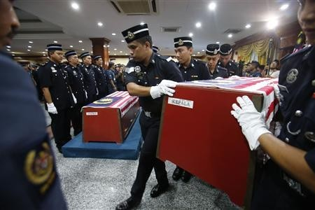 The coffin of Corporal Sabarudin Daud of Malaysian Police 69th Commando Battalion, who was killed on Friday in the standoff between Malaysian security forces and armed followers of the Sultanate of Sulu