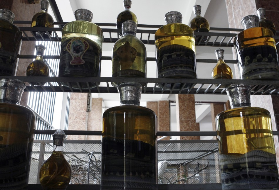 Bottles of snake wine are displayed at a restaurant at Le Mat, dubbed Snake Village, some 10 km 6 miles east of Hanoi May 9, 2007. Le Mat, a village of new houses, old shanty homes, winding alleys and ancient temples with Chinese-style roofs