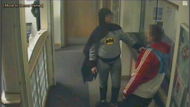 Batman and the suspect at Trafalgar House police station in Bradford (West Yorkshire Police)