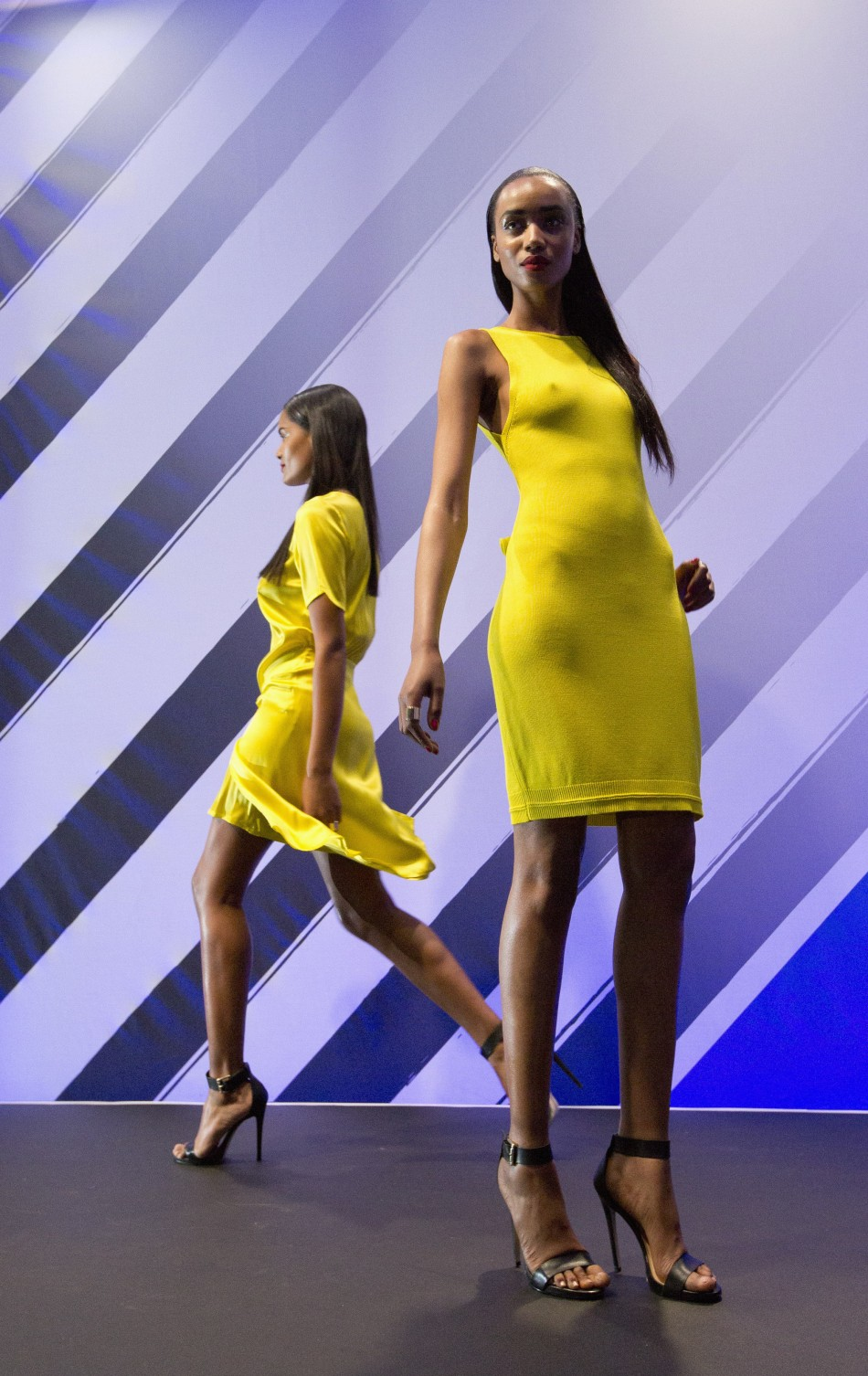 Models present creations from the Rihanna for River Island collection at a store in central London March 4, 2013.