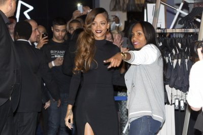 Singer Rihanna attends the launch of her collection Rihanna for River Island at a store in central London March 4, 2013.