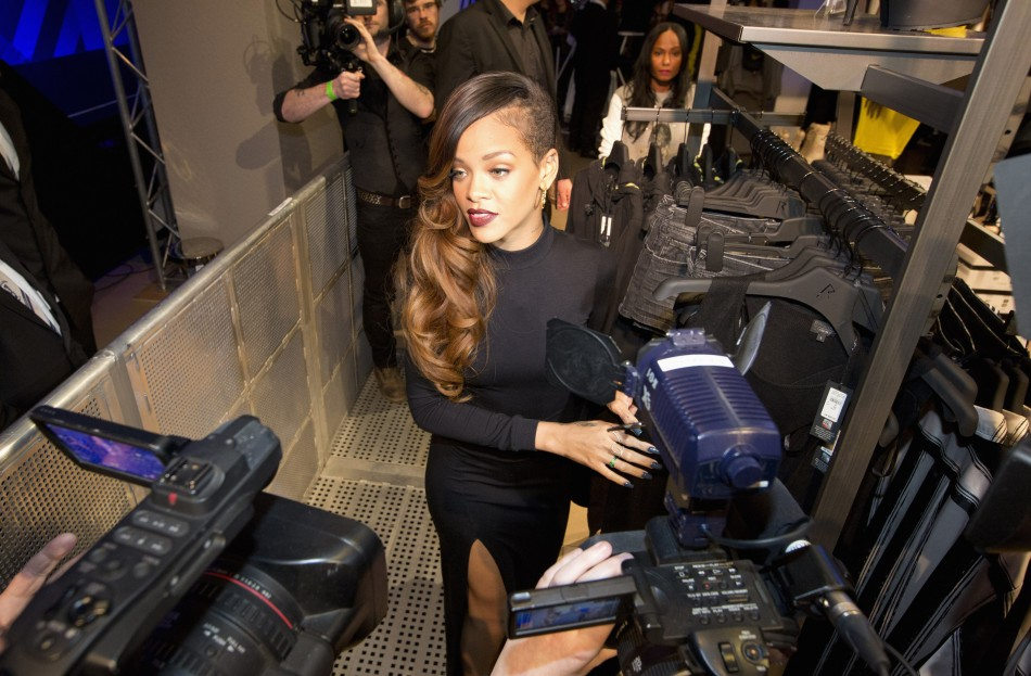 Singer Rihanna poses during the launch of her collection Rihanna for River Island at a store in central London March 4, 2013.