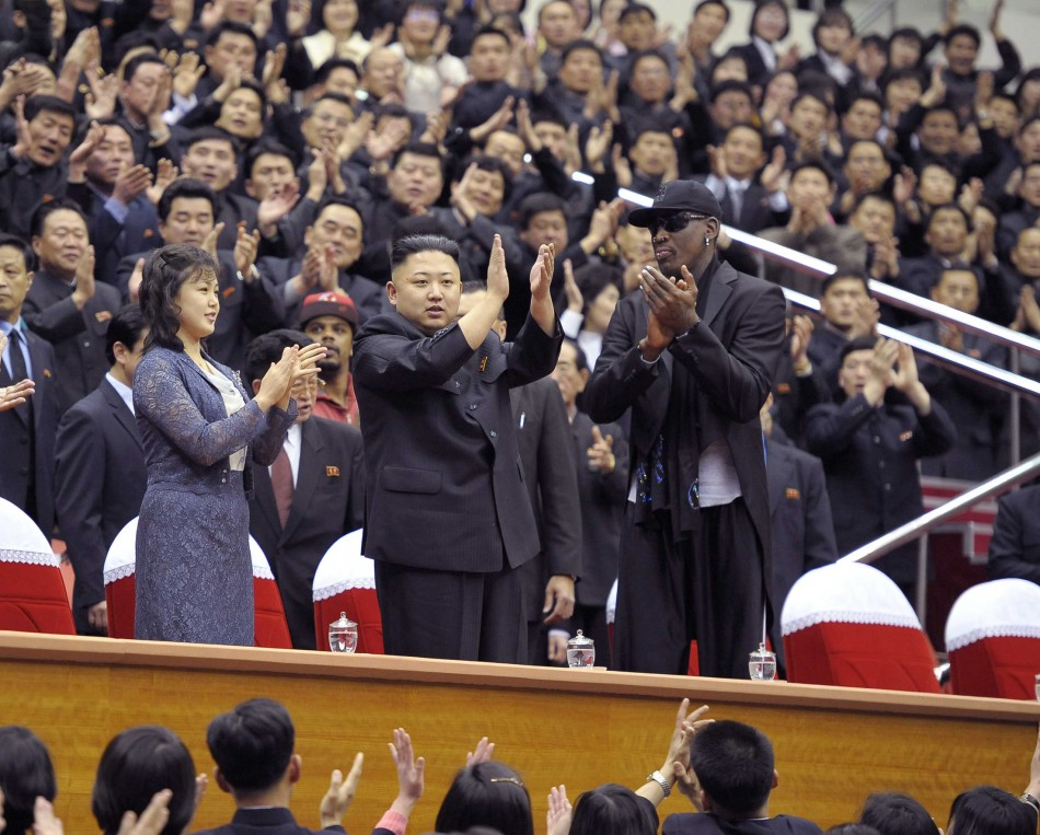 North Korean leader Kim Jong-Un (C), his wife Ri Sol-Ju (L) and former NBA basketball player Dennis Rodman clap during an exhibition basketball game in Pyongyang