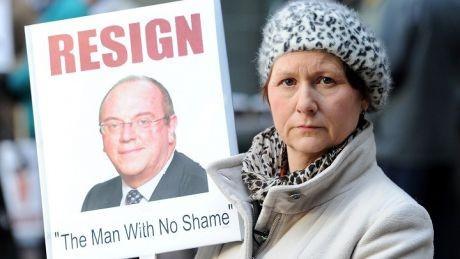Julia Bailey holds placard showing Sir David Nicholson