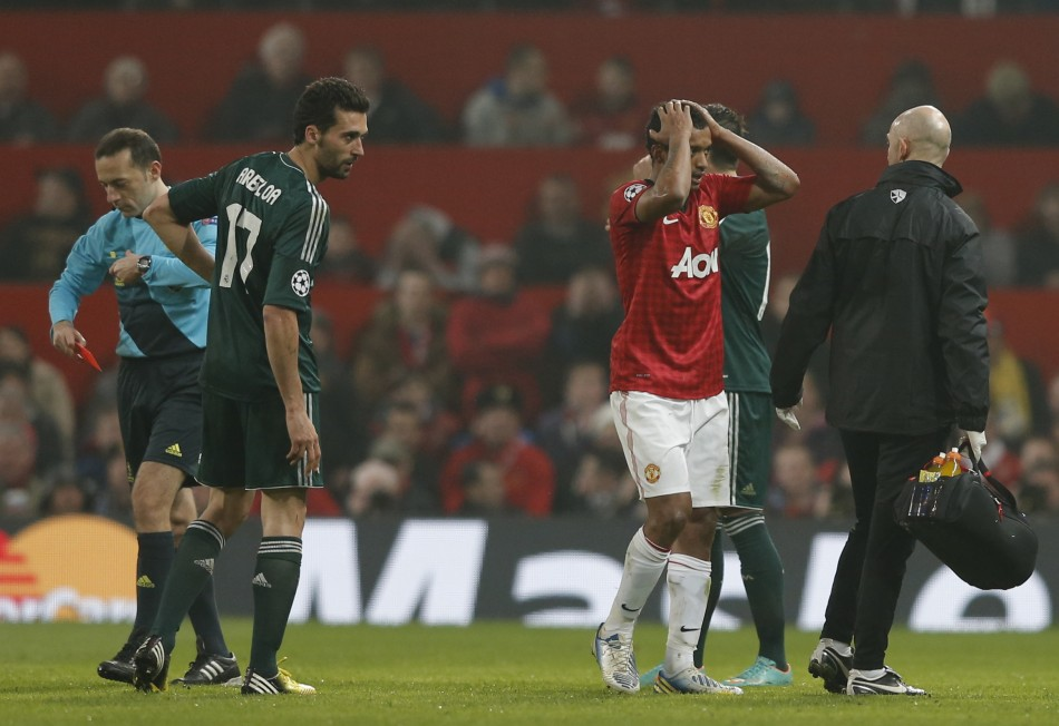 Nani reacts after being sent off as Real Madrid's Alvaro Arbeloa watches during their Champions League match (Reuters)