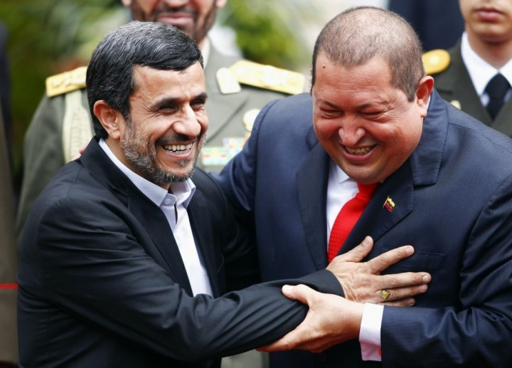 A file photo of Iran's President Mahmoud Ahmadinejad being welcomed by Venezuela's President Hugo Chavez at Miraflores Palace in Caracas - Reuters