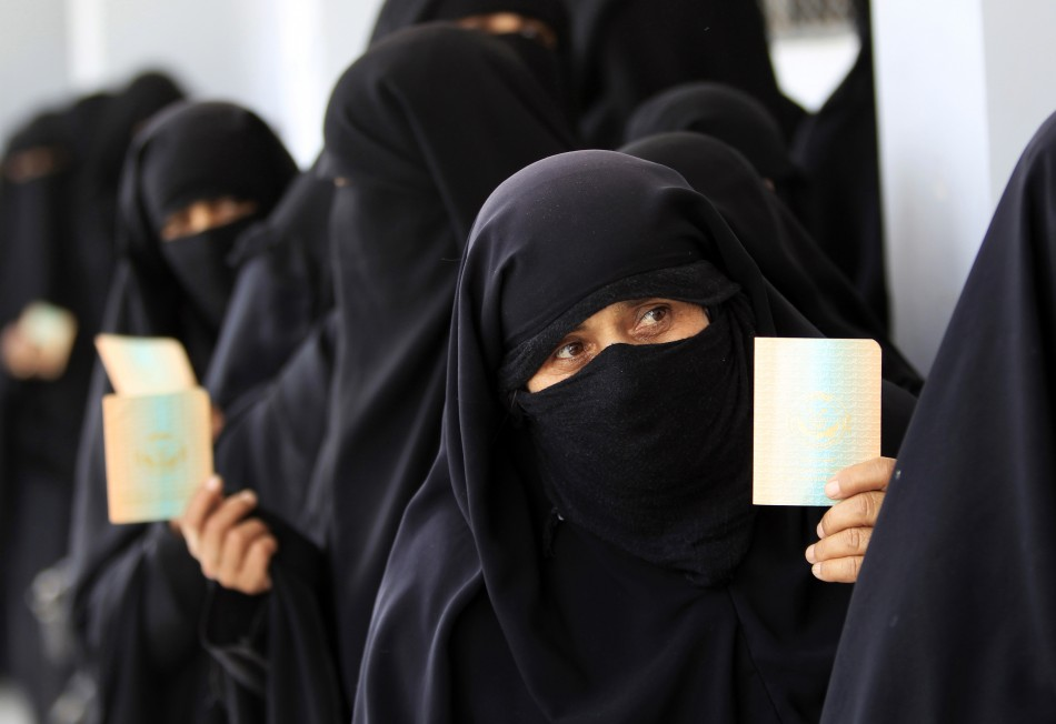 Women queue inside a polling station during presidential elections in Al Hasaba neighborhood in Sanaa February 21, 2012.