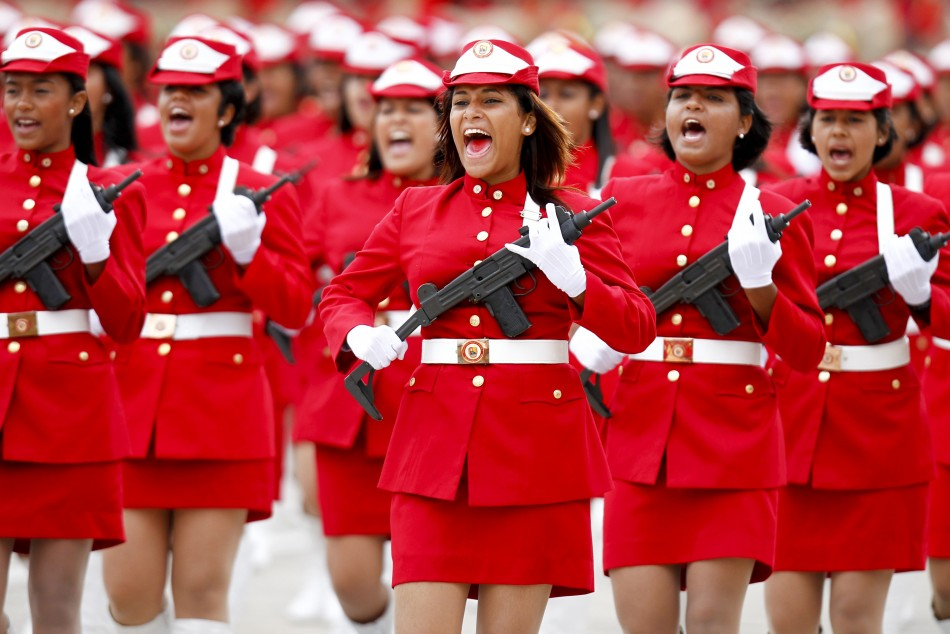 Venezuelan soldiers march during a military parade to commemorate the 20th anniversary of the failed coup attempt on President Hugo Chavez in Caracas February 4, 2012