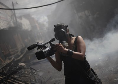 A member of the local media records a fire at the Comayaguela market in Tegucigalpa February 18, 2012.