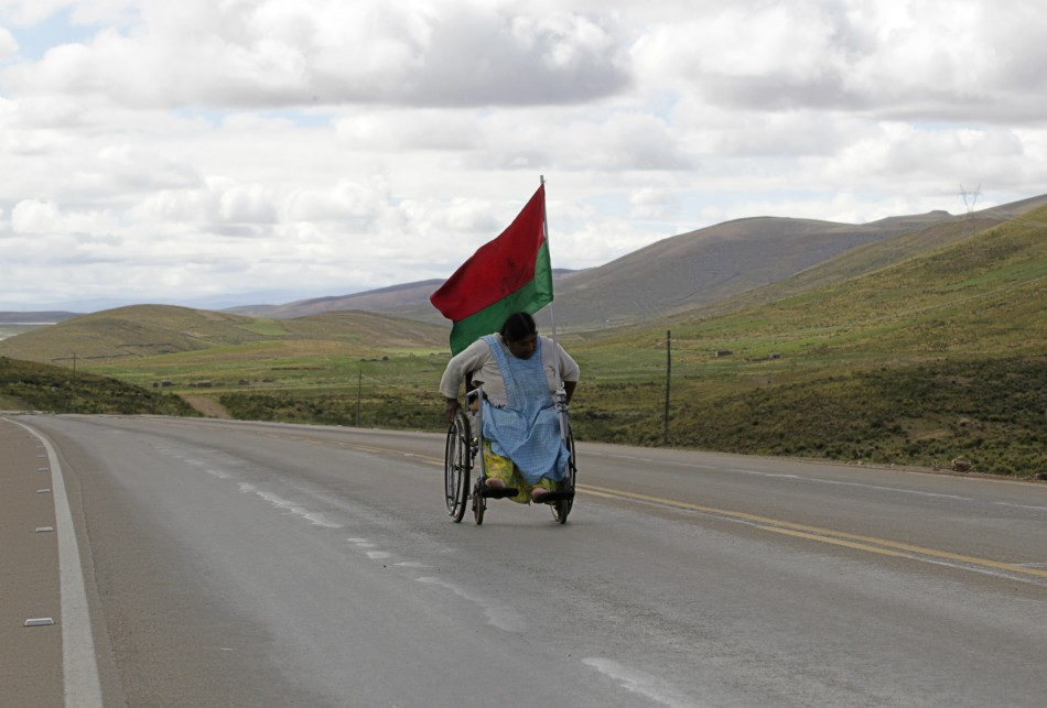 A physically disabled woman on her wheelchair leads a march near Caracollo, some 170 km 106 miles from La Paz, February 11, 2012.