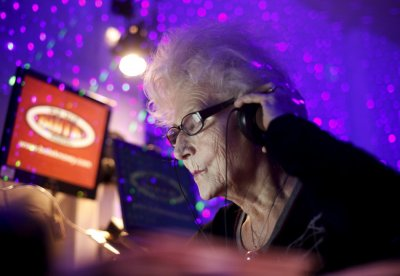 DJ Wika Szmyt plays music at a club in Warsaw January 4, 2012. Szmyt, 73, spends her retirement days behind a DJ console watching people dance to her rhythms. She plays disco, rumba or samba for a mostly elderly audience because she feels she is giving th