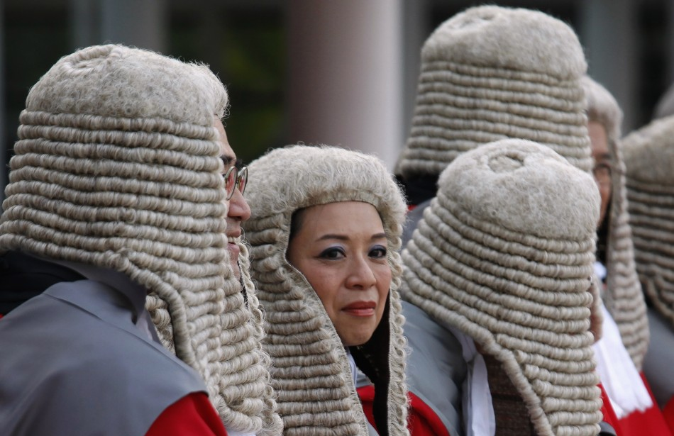 Judges wearing wigs attend a ceremony to mark the beginning of the new legal year in Hong Kong January 9, 2012. The territory continued its common law system after it reverted to Chinese rule in 1997.