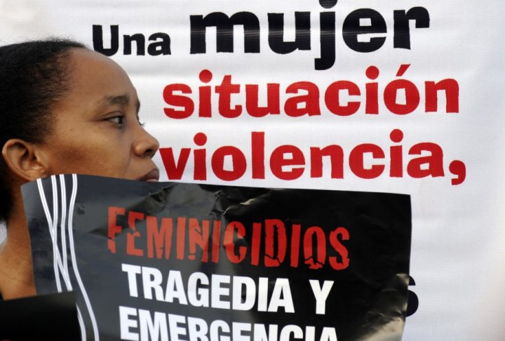 A woman takes part in a rally against femicide, organized by activists and relatives of women who were killed or abused