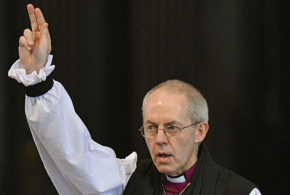 Justin Welby, the new Archbishop of Canterbury, gives a blessing at the close of the ceremony to confirm his election as Archbishop (Reuters)