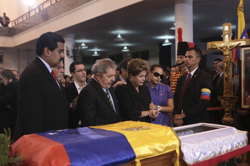 Venezuela Vice-president Nicolas Maduro, former Brazil president Luiz Inacio Lula da Silva, Brazil's current President Dilma Vana Rousseff and Rosa Virginia, daughter of Venezuela's late president Chavez, view Chavez's coffin during a wake at the military academy in Caracas. - Reuters
