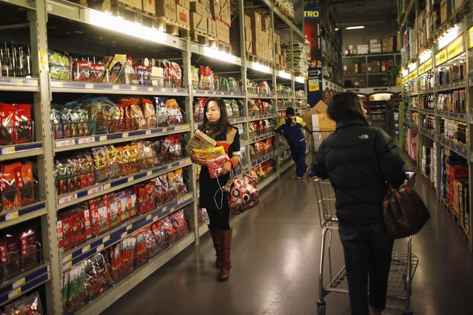 Customers shop at a supermarket