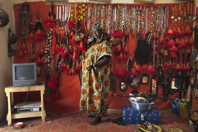 Artisan Hally Bara in Front of Traditional Tuareg and Songhai Headdress Source - ReutersJoe Penney