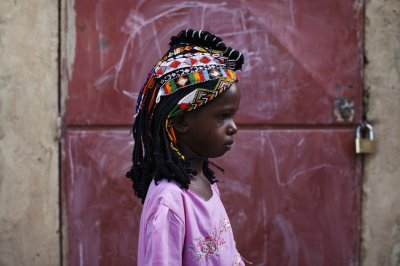 Aminata Toure in Traditional Songhai Headdress Source - ReutersJoe Penney