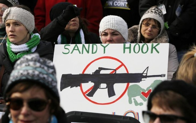 Protesters in the US campaign for tighter gun controls in the wake of the Sandy Hook school shooting in Connecticut that left 26 dead. (Reuters)