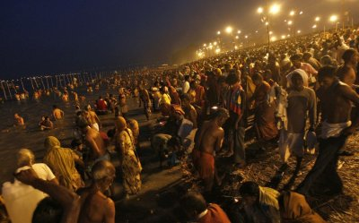 Hindu devotees gather to take a holy dip in the waters of the river Ganges during the early morning on the last bathing day of Kumbh Mela or Pitcher Festival, in the northern Indian city of Allahabad March 10, 2013. During the festival, Hindus